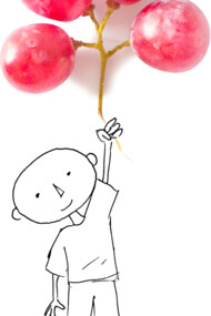 Boy with grape balloons