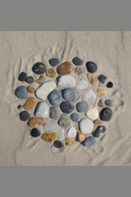Beach stones in the sand